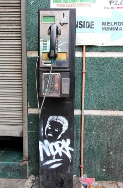pay phone with graffiti