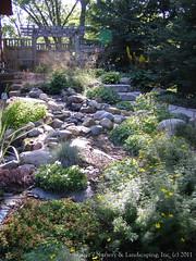 Beautiful outdoor living space... Natural Stone Work & Cedar Pergolas
