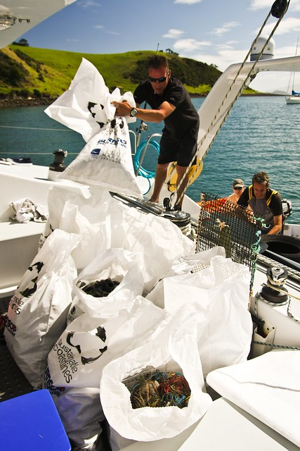 Burnsco crew brings trash onboard