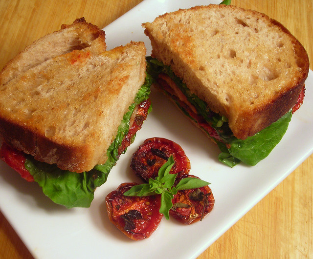 Bacon, sucrine lettuce and slow-roasted Campari cherry tomato sandwich, with Dijon-herb aioli on toasted sourdough bread