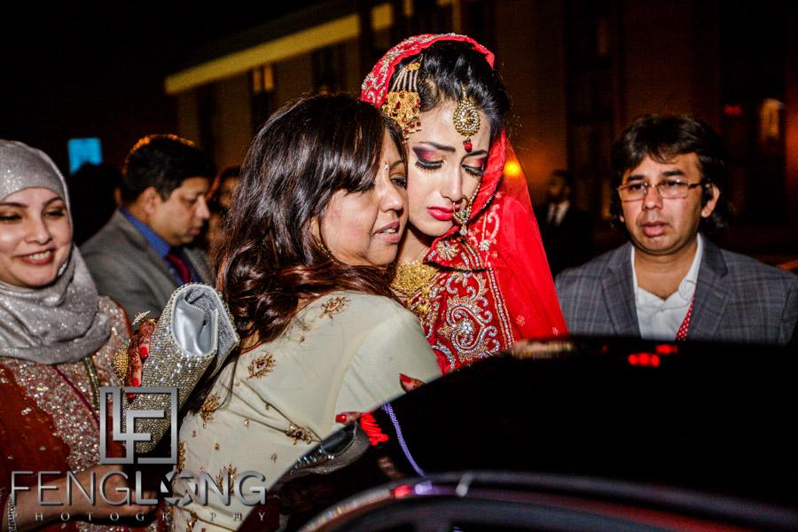 Bride hugs her mother goodbye