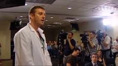 Chris Keefer - Doctor and medical student interrupt Minister Joe Oliver at press conference - pix 01