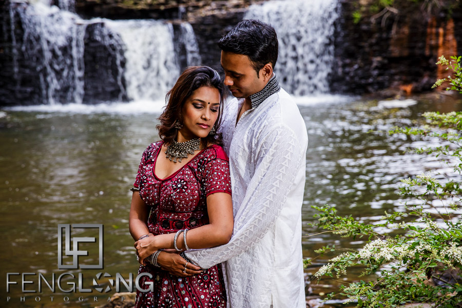 Indian bride and groom in front of waterfall
