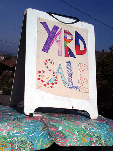 Free-spirited yard sale sign