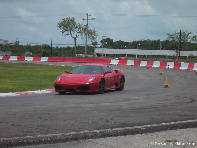 Another driver takes laps around the race track