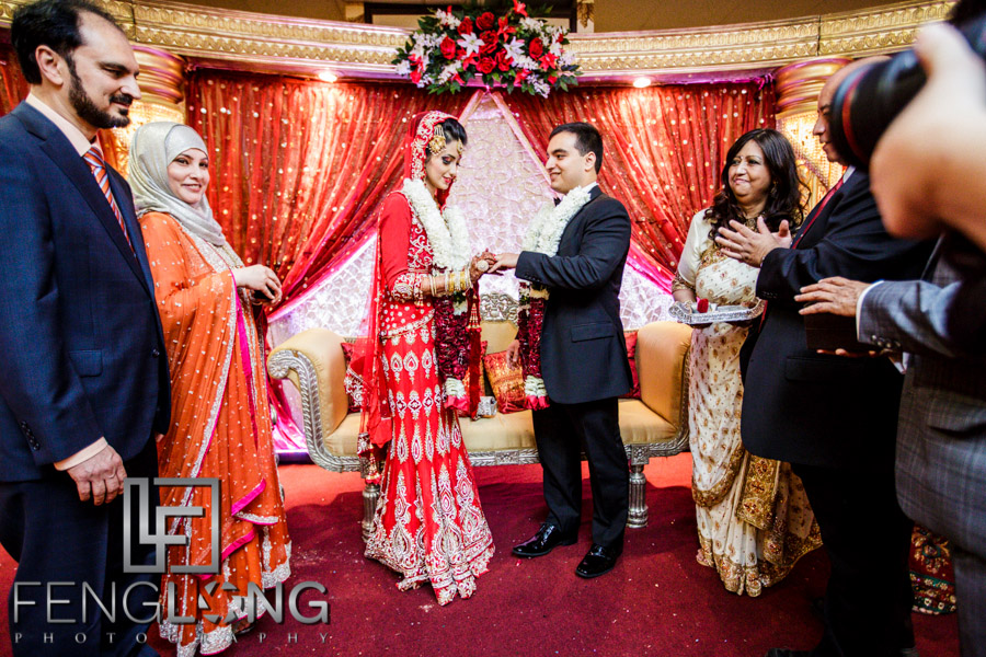 Bride and groom exchange rings during Muslim wedding