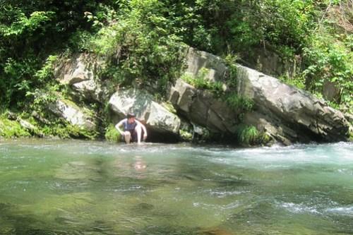 Credit: Katy Dickinson. Jessica Dickinson Goodman jumping into a creek in Elkmont, TN.