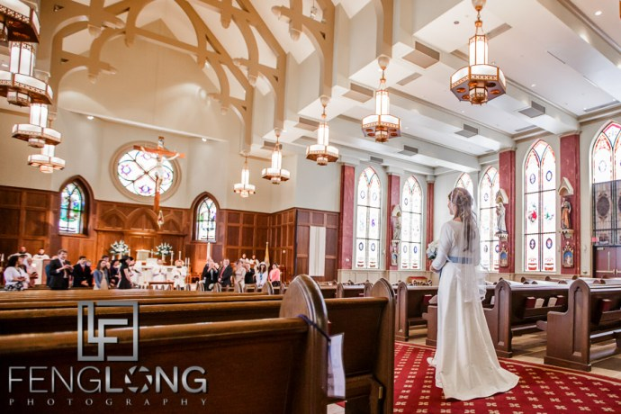 Bride entering the sanctuary during Catholic wedding