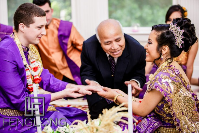 Cambodian bride and groom exchange rings during wedding ceremony