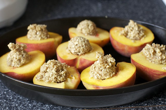 dollop almond crisp in peach bellies