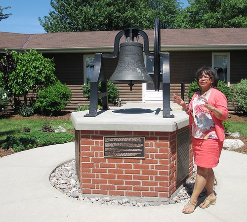 Ms. Shannon Prince, curator of the Buxton National Historic Site & Museum explaining the significance of the bell.