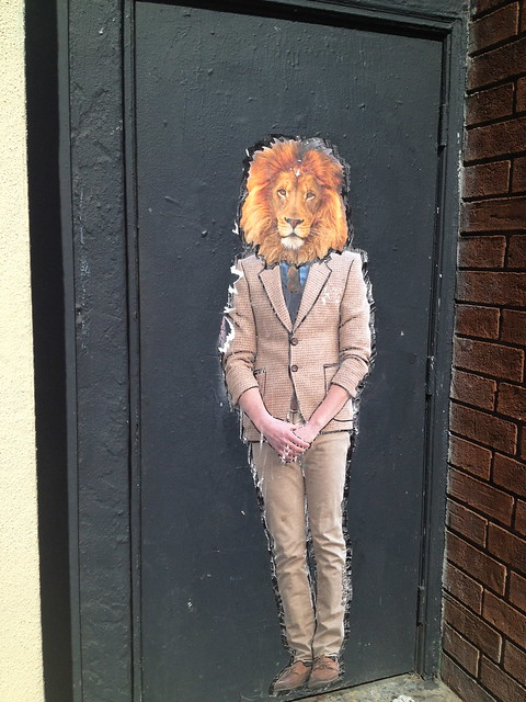 Lion-headed man doorway art