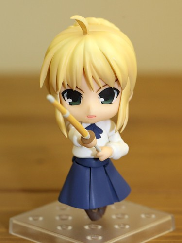 Holding the wooden sword with angered expression
