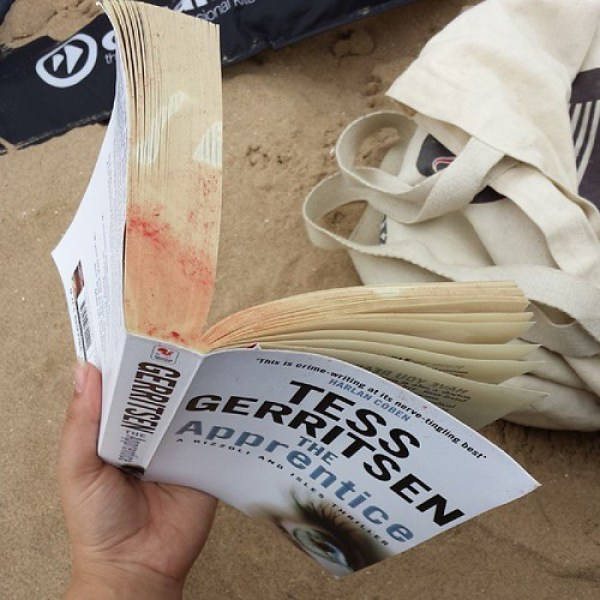 My fruit tub thing leaked in my bag. Now my crime novel looks like a crime scene! #tessgerritsen #theapprentice