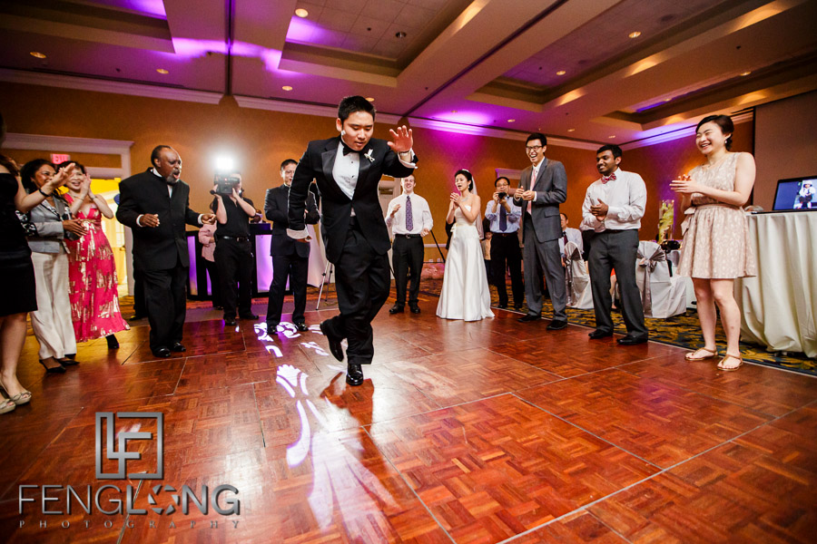 Chinese bride and groom dance during wedding reception at Chateau Elan