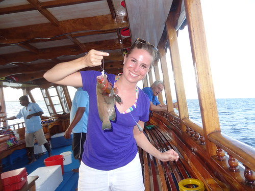 Holding the grouper fish I caught while hand line fishing