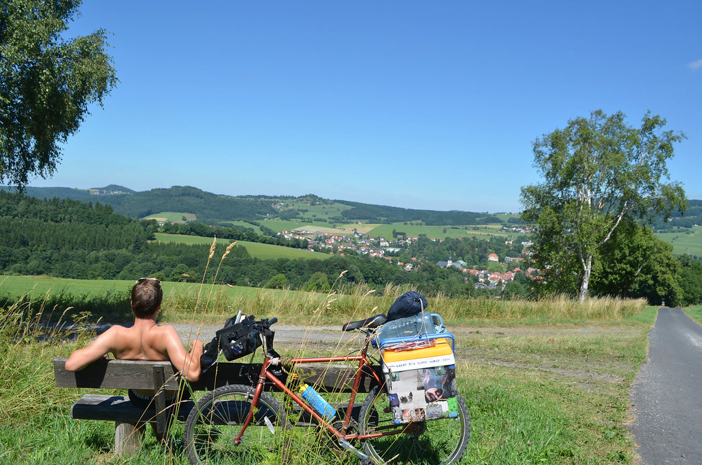 34 relaxing on a bench atop german countryside hills