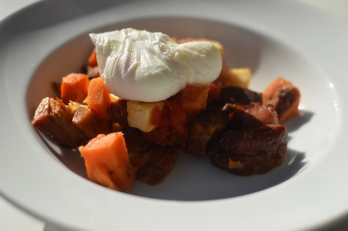 Chunky bacon and sweet potato hash with a poached egg