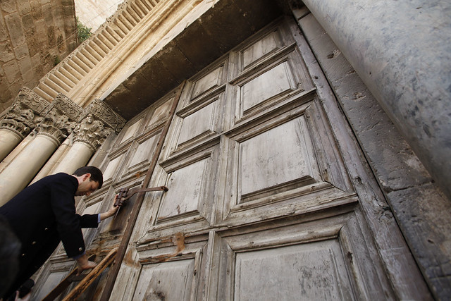 Muslim Gatekeeper Locks the Door to the Church of the Holy Sepulchre on Holy Thursday