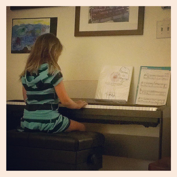Working on memorizing her recital pieces!