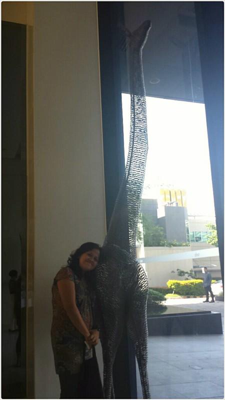 big giraffee metal art by tye reception area at Seda Hotel