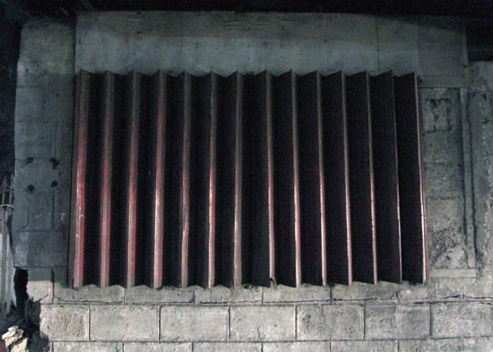 drawn metal accordion window