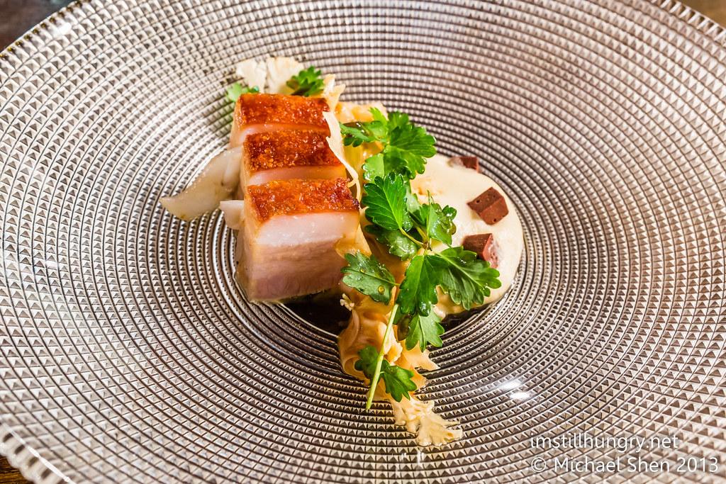 Roast kurobuta pork belly w/anchovy juice, raw cauliflower & poached cuttlefish Tomislav