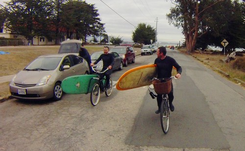 Surfers with bikes
