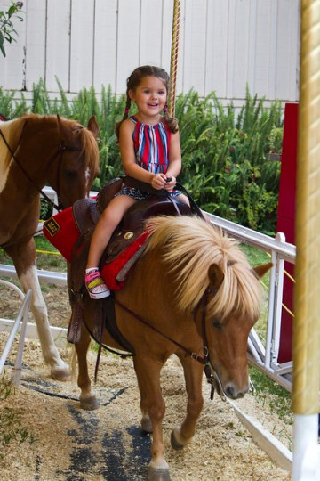 LOVES the pony ride
