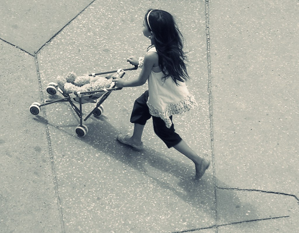 Little Romany Girl with Toy Baby Carriage