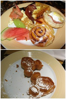 A plate of food and Mickey shaped waffles.