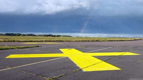 Yellow cross and rainbow