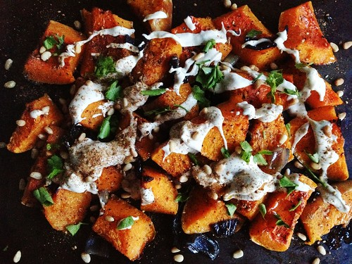roast butternut squash and red onions, with tahini lemon sauce and pine nuts