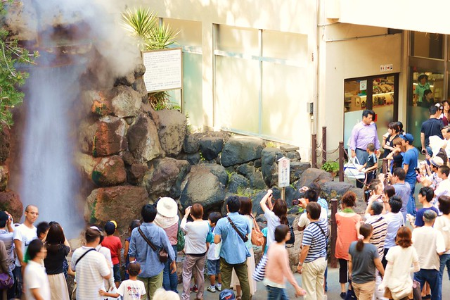 tourists in beppu at water