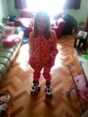 Millie in onesy and roller boots