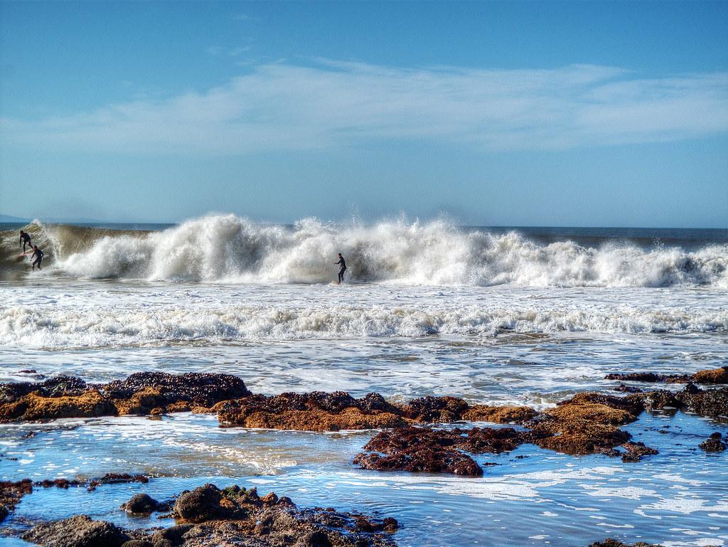 A surfer catching a wave, Jeffreys Bay, ZA.
