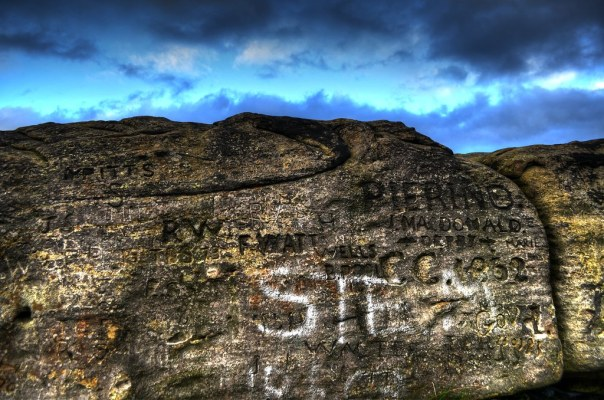 Cow and Calf Rock With Writing