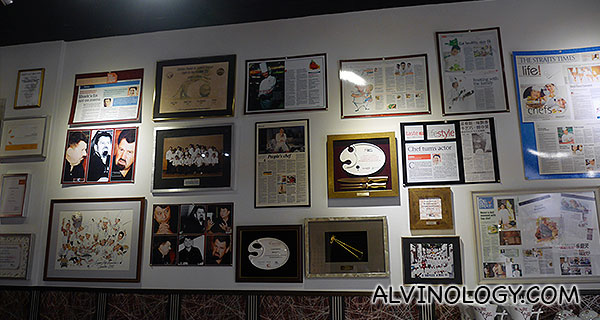 Media coverages on Chef Teo adorned the wall of his studio