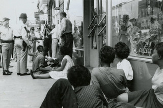 Police arrest protesters outside College Shoppe, Main St., Farmville, Va., July 27, 1963