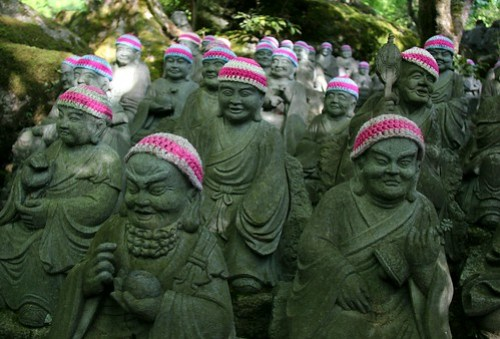 Buddhas in knitted hats