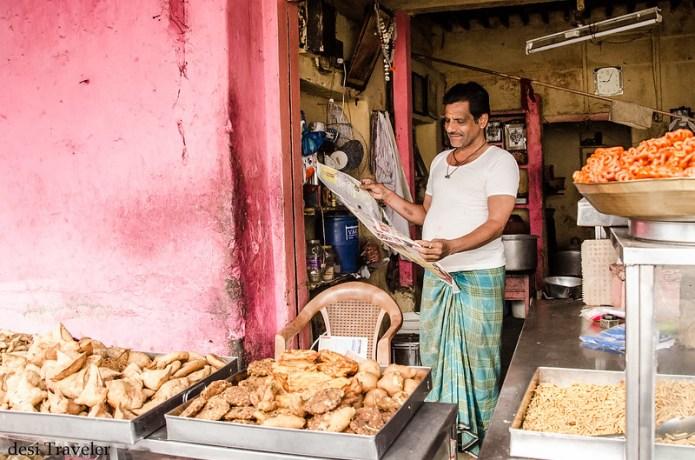 sweet shop man reading newspaper