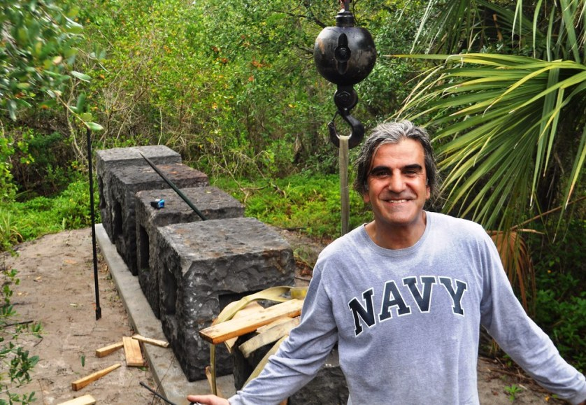 "Turkish Artist Kemal Tufan during the Instalation of ""Keel"" at the Peace River Botanical & Sculpture Gardens in Punta Gorda, Fla., June 2014."