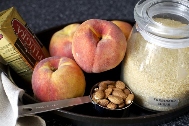 butter + peaches + almonds + sugar