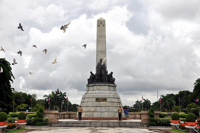 Doves hovering around the Rizal Monument