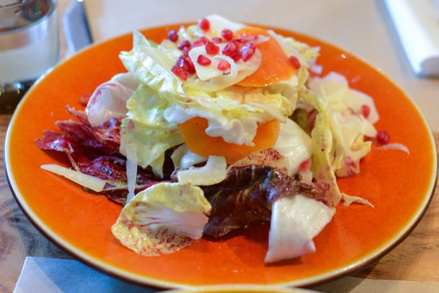 chicories with persimmon and piave cheese