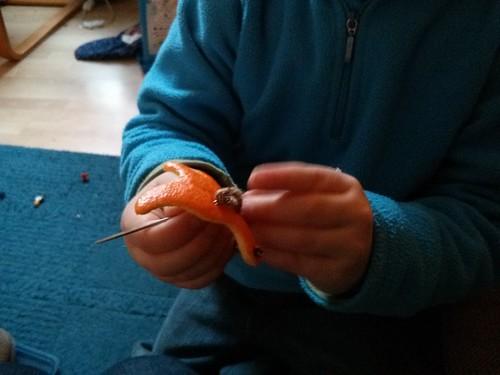 orange dinosaur sewing