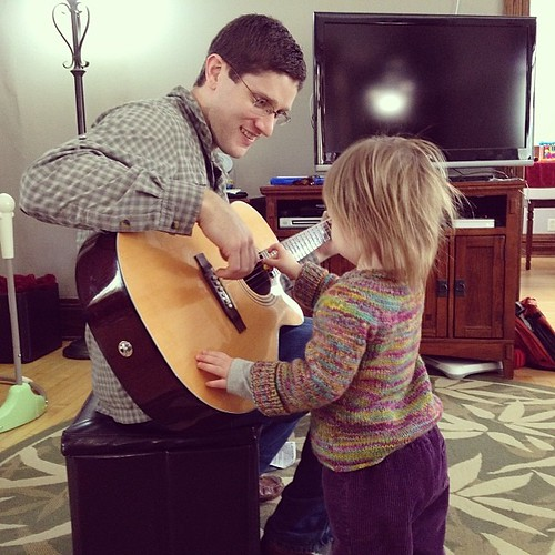 Playing guitar with her uncle.