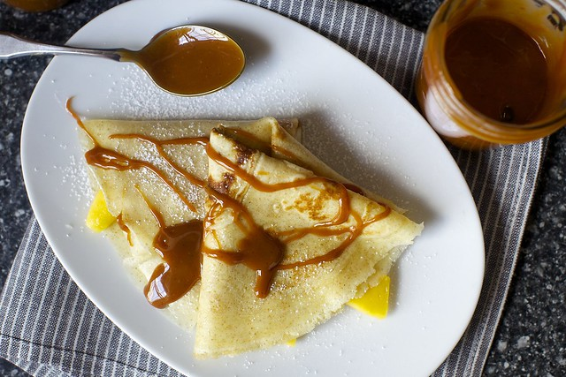dulce on a crepe with banana and mango