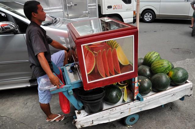 Watermelon Man on a Street Corner