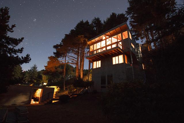 Beach house at night